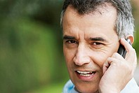 Close-up of a mid adult man talking on a mobile phone