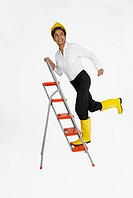 Female architect climbing a ladder and smiling