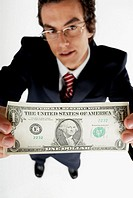 Portrait of a businessman holding an American dollar bill