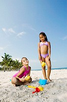 Portrait of two girls playing on the beach