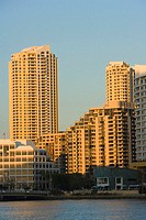Low angle view of skyscrapers at the waterfront, Miami, Florida, USA