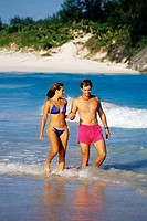 Side view of a couple in swimsuits, Horse-shoe Bay beach, Bermuda