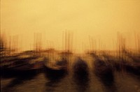 Defocused view of boats moored at a dock, Italy