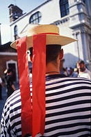 Rear view of a person wearing a straw boater hat, Italy
