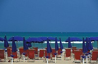 Beach chairs and beach umbrellas on the beach, Italy (thumbnail)