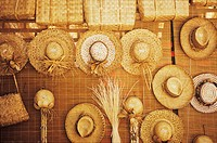 Straw hat hanging at a market stall, Hawaii, USA