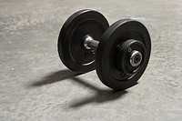 Dumbbell on concrete floor