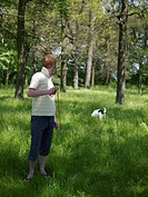 Young man in park with dog