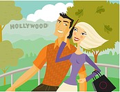 Couple walking in front of HollyWood sign, woman talking on a cell phone