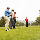 Four men playing golf