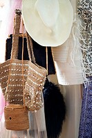 Hats, bags, and garments hung on a coatrack