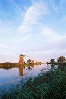 The Netherlands, Holland, Kinderdijk, windmills lining canal, sunrise