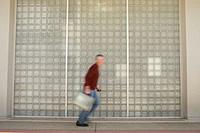 Businessman running with briefcase (blurred motion)