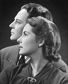 Couple posing in studio (B&W), portrait