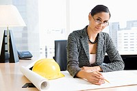 Woman architect at her desk (thumbnail)
