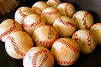 Used baseball balls.