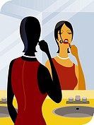 A woman applying lipstick (thumbnail)
