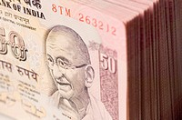 Close-up of a picture of Mahatma Gandhi printed on Indian fifty rupee banknote