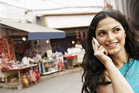Close-up of a young woman talking on a mobile phone (thumbnail)