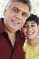 Portrait of a grandfather and his grandson smiling