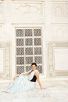 Side profile of a young woman sitting in a mausoleum, Taj Mahal, Agra, Uttar Pradesh, India