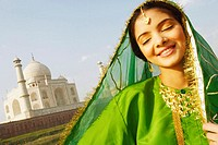 Close-up of a young woman smiling with her eyes closed, Taj Mahal, Agra, Uttar Pradesh, India