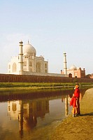 Side profile of a priest standing on the riverbank, Taj Mahal, Agra, Uttar Pradesh, India
