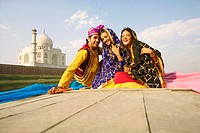 Portrait of a young man and two young women sitting in a boat, Taj Mahal, Agra, Uttar Pradesh, India