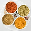 High angle view of spices in four bowls