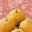 Close-up of four Ladoos
