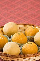 Close-up of Ladoos in a basket