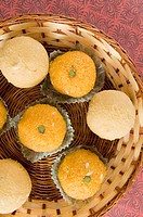 High angle view of Ladoos in a basket (thumbnail)