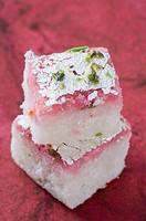 Close-up of a stack of Burfi garnished with Pistachio