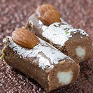 Close-up of a chocolate roll garnished with Almonds