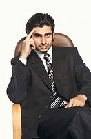 Portrait of a businessman with his head in his hand (thumbnail)