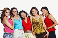 Portrait of five young women standing together and smiling