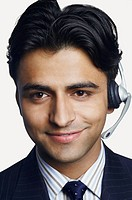 Portrait of a male customer service representative smiling