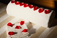 High angle view of rose petals on towels