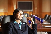 Portrait of a businesswoman sitting in a conference room and smiling