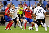 Sport, football, world championships, Germany versus Costa Rica, 4:2, Munich, 9 6 2006, from left to right, Danny Fonseca, Bastian Schweinsteiger, ref...