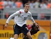 Sport, football, world championships, England versus Trinidad and Tobago, 2:0, Nuremberg, 15 6 2006, from left to right, Peter Crouch, Brent Sancho, s...