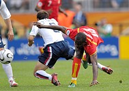 Sport, football, world championships, Ghana versus United States, 2:1, Nuremberg, 22 6 2006, from left to right, Cherundolo, Matthew Amoah, footballer...
