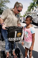Police Department, Open House, Segway Unit demonstration, Black girl, policewoman. North Miami Beach. Florida. USA