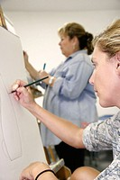Painting class, Hispanic female, easel, sketch. Art Center South Florida. Lincoln Road Mall. Miami Beach. Florida. USA.