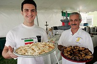 Iran, Persian, men, trays, cookies, desserts, food. Iranian Festival. Bayfront Park. Miami. Florida. USA.