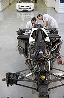 Mechanics working on racing car, World Series, Formula 3000. Epsilon Euskadi, car technology high performance centre , Azkoitia, Gipuzkoa, Basque Coun...