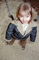 Portrait of girl near swing