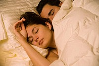 Couple, hispanic, age 20´s and 30´s, sleeping, bed
