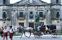Horse cart on road in front of sculpture, Matanzas Province, Cuba