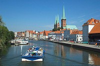 Tour boat sailing in river, Schleswig_Holstein, Germany